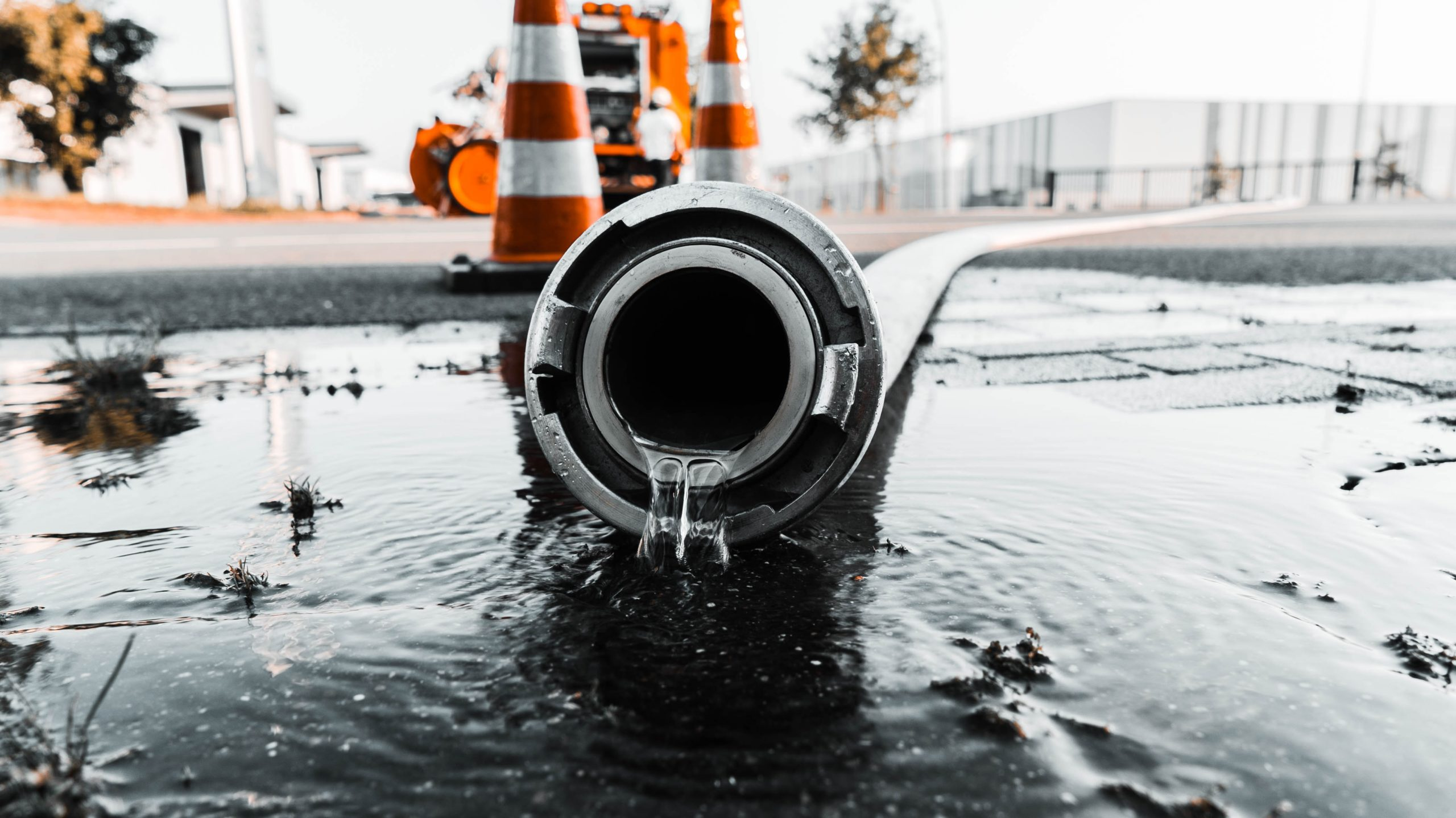 """Water coming out of pipe"" Photo by Daan Mooij on Unsplash"